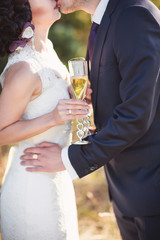 Bride and groom with champagne glasses in wedding day