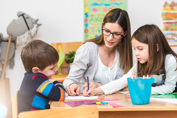 Teacher Working with Children in Preschool Classroom