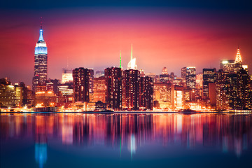 Wall Mural - New York City skyline of Manhattan with vibrant night colors