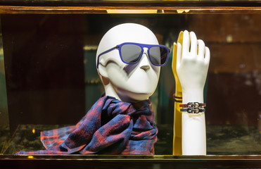 Male mannequin head in sunglasses and scarf
