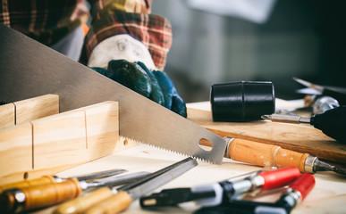 Carpenter holding a hand saw