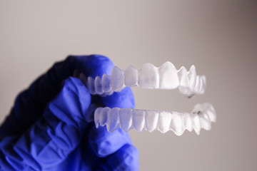 Dental orthodontics held by dentists hand