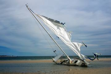 Broken yacht with a torn sail aground. Gulf Coast, Florida, St.
