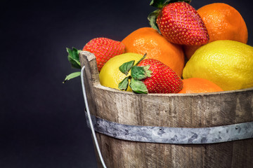 fruit gathered in a rustic wooden bucket