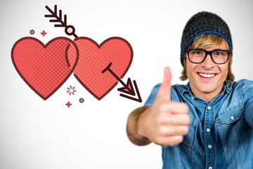 Composite image of smiling hipster with thumbs up