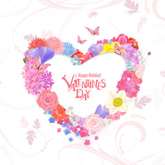 floral wreath of heart shape of different spring flowers and wit