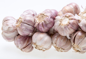 String of garlic isolated on white background