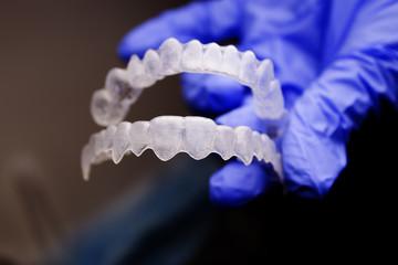 Dental orthodontics held by dentists hand
