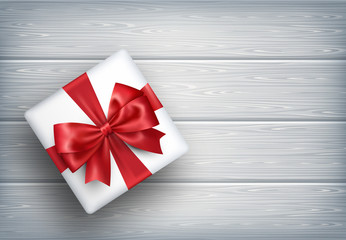 Present Gift Box with Bow on Wooden