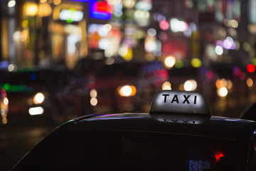 Taxi roof on a background of neon signs night city