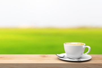 Coffee cup on the wood table over blur green nature background. 3D illustration