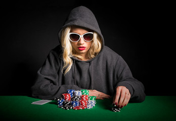 Professional poker player with glasses making poker face