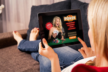 Woman playing poker on tablet