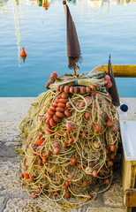 Fishing nets placed on the dock of a port by fishermen