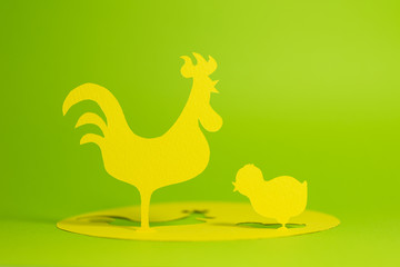 Parent and child of chickens, illustrated by a paper cutout which drawn without reference images.