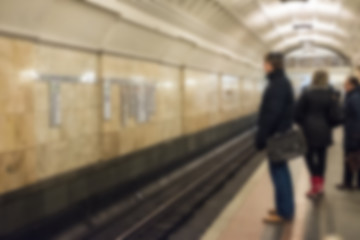 Blurred image of people walking around Metro station in Moscow.