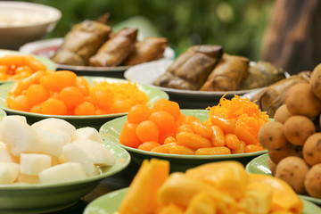 Sweety Gloden Drop Thai Desserts and fruits on dish in banquet