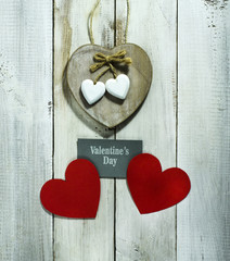Valentine's Day card with hearts on old wooden background