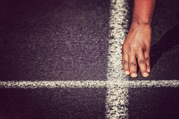 Hand at the starting line in a track and field race