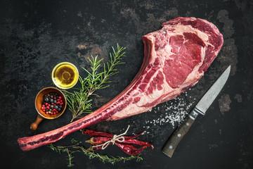 Dry aged raw tomahawk beef steak