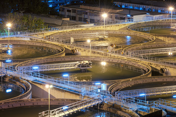 Modern urban wastewater treatment plant.Water purification is the process of removing undesirable chemicals, suspended solids and gases from contaminated water. Water cleaning facility outdoors.