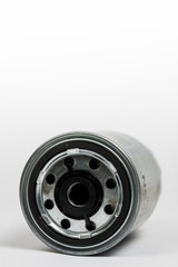 Metal car fuel filter isolated over white background