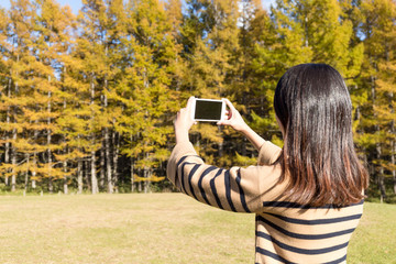 Woman using cellphone to take photo