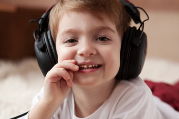 handsome boy listening to music on headphones