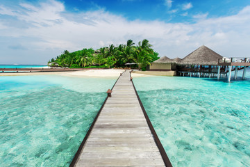 Wall Mural - Water bungalows resort at islands. Indian Ocean, Maldives