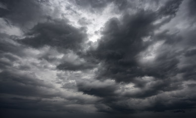 Dramatic thunderstorm clouds background at dark sky