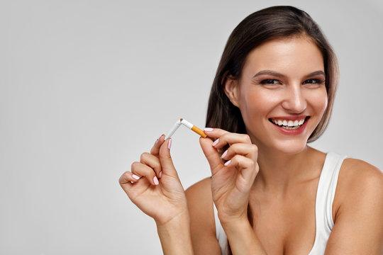 Quit Smoking. Beautiful Happy Woman Holding Broken Cigarette