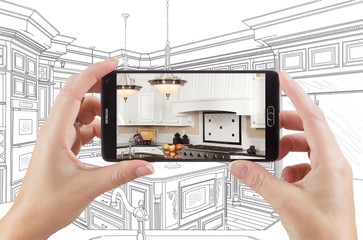 Hands Holding Smart Phone Displaying Photo of Custom Kitchen Drawing Behind.