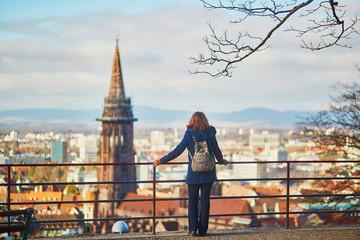 Girl enjoying panorama of Freiburg im Breisgau in Germany