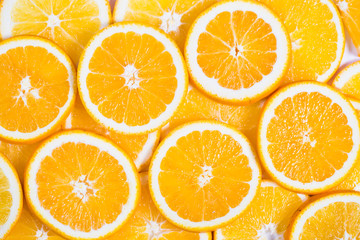 Sliced orange background. Food and drink