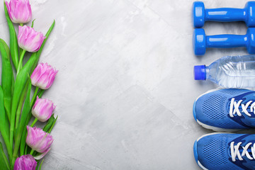 Spring flatlay composition with sport equipment and tulips.