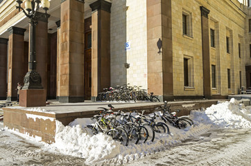Big group of bicycles in snowdrift.