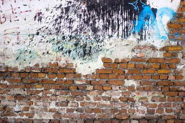 weathered brick wall with plaster peeling off, grunge texture