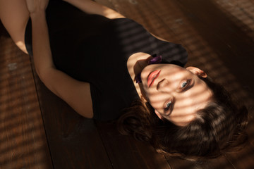 beautiful girl lying on the floor of the light