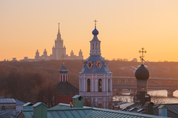 Moscow, View of the Moscow State University, domes of churches and bell towers of St. Andrew's Monastery in the background of a spring sunset