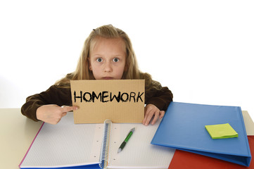 Young Male Student Is Overwhelmed By Way Too Many Homework     Dreamstime com Stock Photo   Young female elementary school student is shocked and  overwhelmed by homework or schoolwork