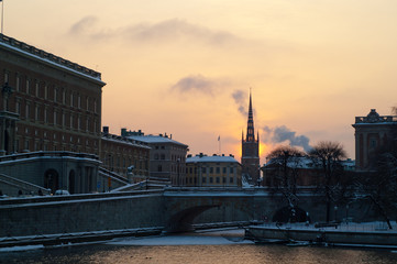 Winter sunset behind a spire of Riddarholmen church, Stockholm, Sweden