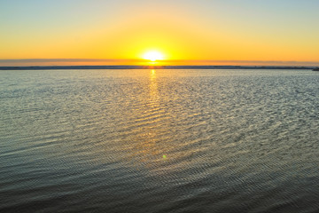 Ocean sunset background and empty space for your text. Calm and peaceful ocean with golden background. Peace, relaxation, summer, holidays concept. Copy space.