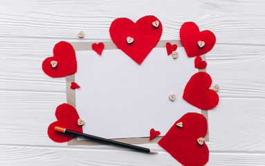 Valentine's Day. love letter, heart felt and decor on wooden background