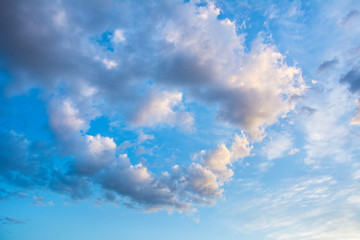Beautiful blue sky with clouds in the shape of heart. Abstract b