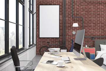 Home office interior with brick walls, large windows, a computer standing on a wooden table and an office chair near it. 3d rendering. Mock up