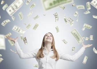 Blond woman under dollar rain