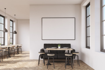 Coffee shop interior with a large sofa near a white wall, a row of tables with chairs near windows and a big horizontal poster on the wall, wooden floor. 3d rendering. Mock up.