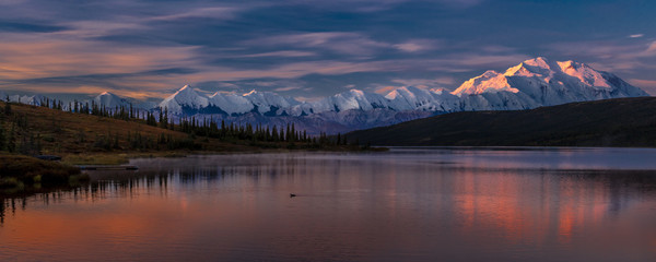 AUGUST 29, 2016 - Mount Denali at Wonder Lake, previously known as Mount McKinley, the highest mountain peak in North America, at 20, 310 feet above sea level. Located in the Alaska Range, Denali National Park and Preserve, Alaska - shot at Sunrise.