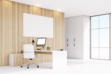 Corner of CEO office with window, computer