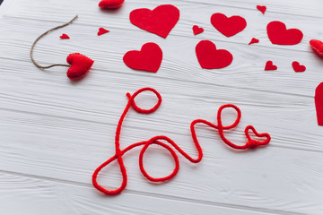 Valentine's Day. felt heart ,toys and decor on wooden background